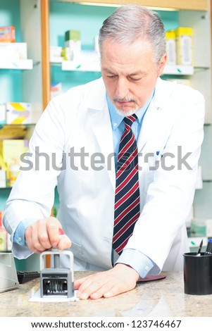 Portrait of a pharmacist at work