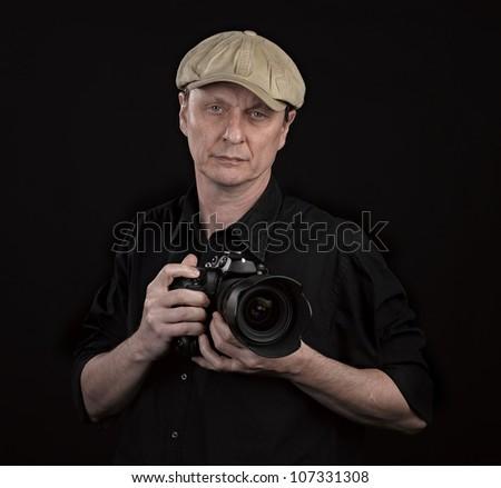 Portrait of a Photographer on black - stock photo