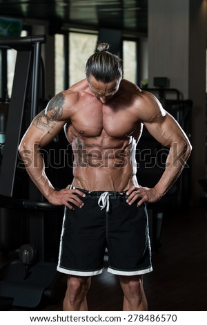 Portrait Of A Physically Fit Man In Modern Fitness Center - stock photo