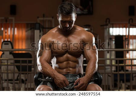 Portrait Of A Physically Fit Man Resting In A Health Club - stock photo