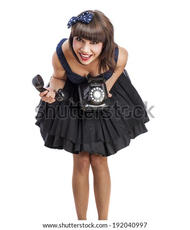 portrait of a pinup woman holding a telephone