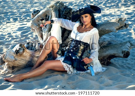 Portrait of a pirate woman at the beach - stock photo