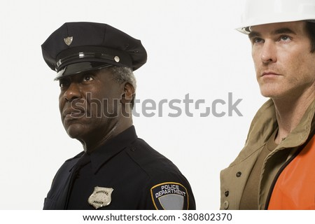 Portrait of a police officer and a construction worker - stock photo