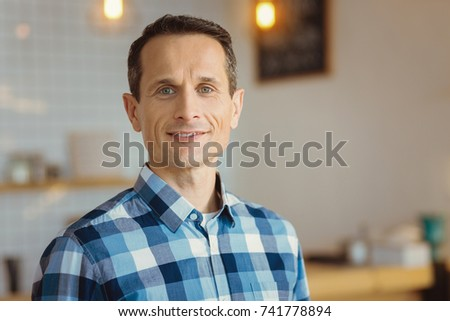 Portrait of a positive cheerful man