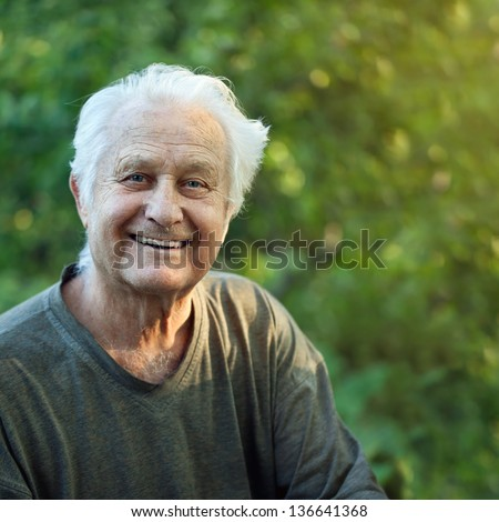 Portrait of a positive elderly man - stock photo