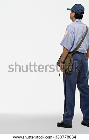 Portrait of a postman - stock photo
