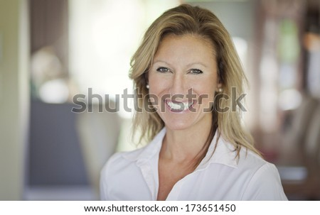 Portrait of a pretty adult woman smiling at the camera - stock photo