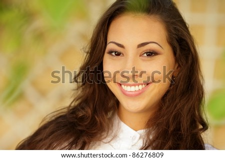 Portrait of a pretty asian caucasian woman standing outdoors