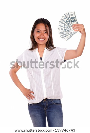 Portrait of a pretty asiatic young female with cash money looking at you against white background