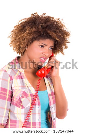 Portrait of a pretty black young woman talking on phone - stock photo