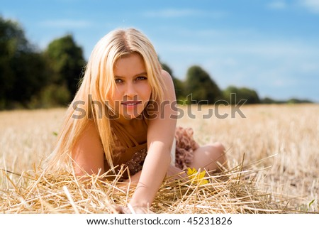 Portrait of a pretty blonde in the field
