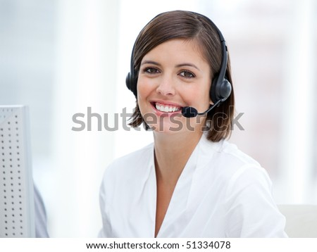 Portrait of a pretty customer agent at work in the office - stock photo