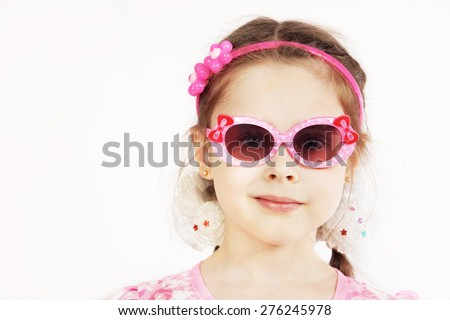 Portrait of a pretty cute young girl wearing pink sunglasses - stock photo