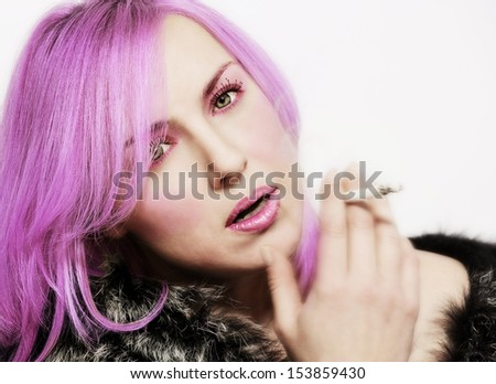 portrait of a pretty fashion girl with Purple Hair - stock photo