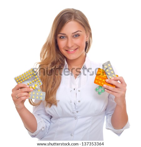 portrait of a pretty female doctor with pills in hand isolated on white background