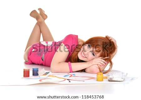 portrait of a pretty girl drawing on the floor - stock photo