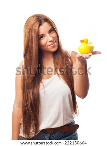 portrait of a pretty girl holding a yellow duck toy - stock photo