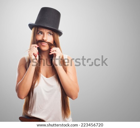 portrait of a pretty girl imitating a man - stock photo