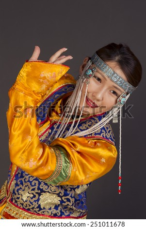 Portrait of a pretty girl in Buryat national clothes