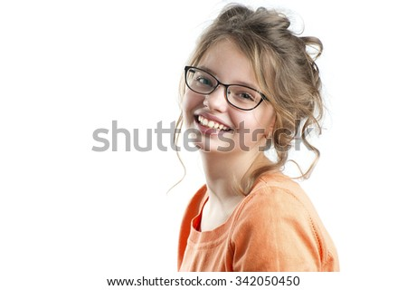 Portrait of a pretty girl on a white background.  Age of child 10 years. - stock photo