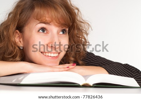 portrait of a pretty girl with a book