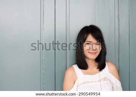Portrait Of A Pretty Happy asian young woman. - stock photo