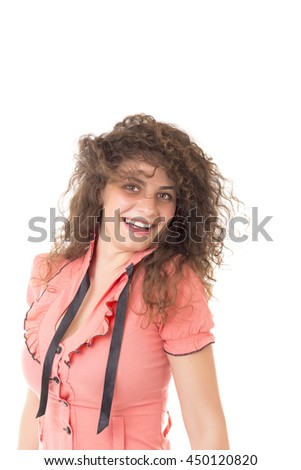 Portrait of a pretty happy curly girl over white background - stock photo