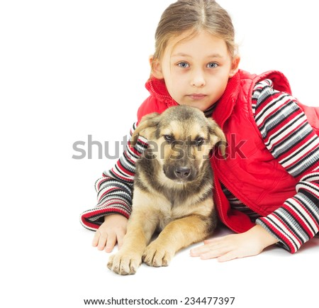 portrait of a pretty little girl in a red vest and a puppy on a white background isolated