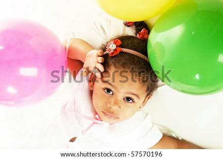 Portrait of a pretty little girl with colorful balloons - stock photo