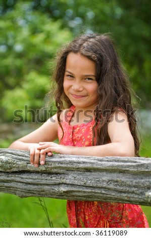 portrait of a pretty little Latino girl outdoors