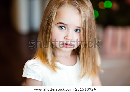 Portrait of a pretty serious girls baby blonde with straight hair,looking to the side , close up - stock photo