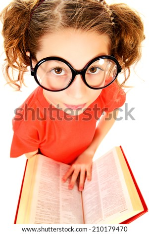 Portrait of a pretty ten years girl in spectacles looking at camera. Isolated over white.