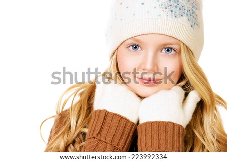 Portrait of a pretty ten years girl in warm clothes smiling at camera. Isolated over white. - stock photo