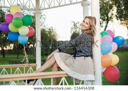 Portrait of a pretty woman in a park against the sunset, outdoors - stock photo