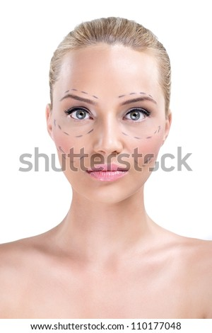 Portrait of a pretty woman's face marked with lines for facial cosmetic surgery - stock photo