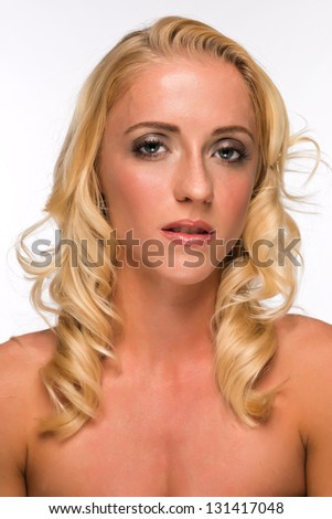 Portrait of a pretty young blonde in a tube top