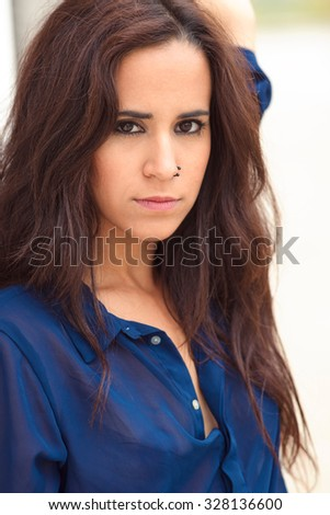 portrait of a pretty young brunette with Hispanic features