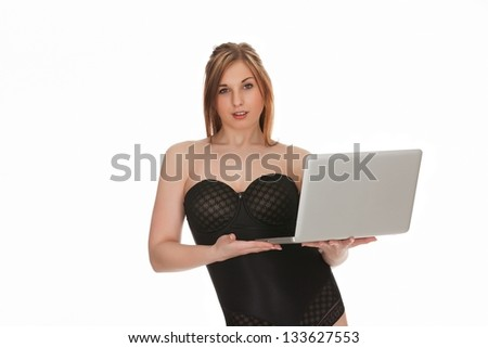 Portrait of a pretty young businesswoman holding a laptop on a white background