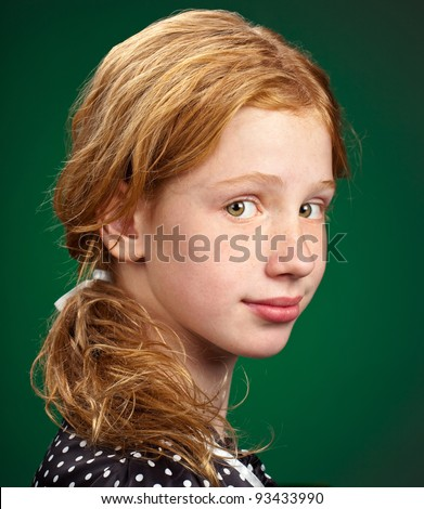 Portrait of a pretty young child on green.