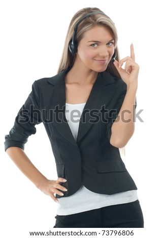Portrait of a pretty young female call center employee wearing a headset with finger pointing up, against white background - stock photo