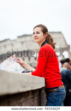 Portrait of a pretty, young, female tourist in Rome, Italy (with Colosseum in the background) - stock photo