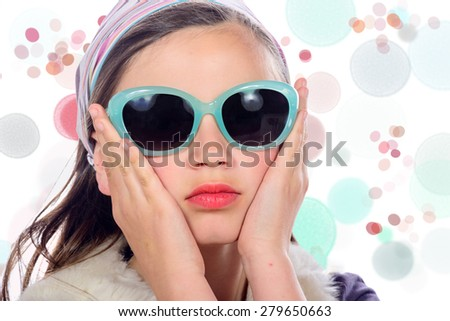 portrait of a pretty young girl with  blue sunglasses