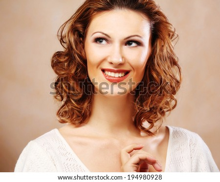 Portrait of a pretty young laughing woman - stock photo