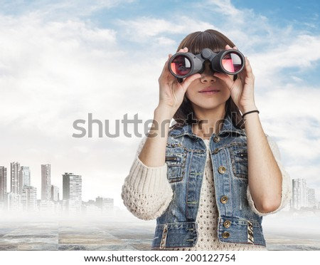 portrait of a pretty young woman looking through of the binoculars