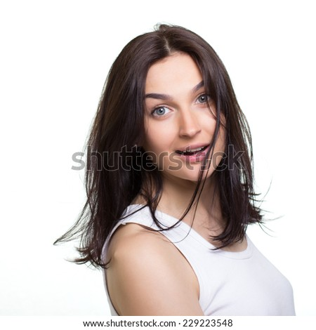 Portrait of a pretty young woman on a white background
