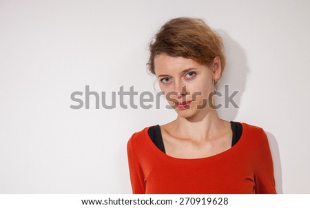 Portrait of a pretty young woman on white background - stock photo