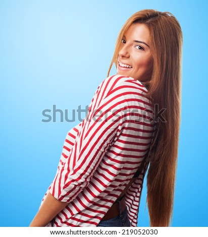 portrait of a pretty young woman posing with smiling gesture - stock photo