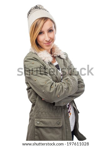 portrait of a pretty young woman wearing a wool cap - stock photo