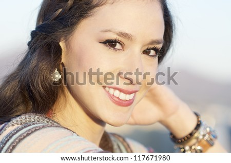 Portrait of a pretty young woman with lovely happy  smile