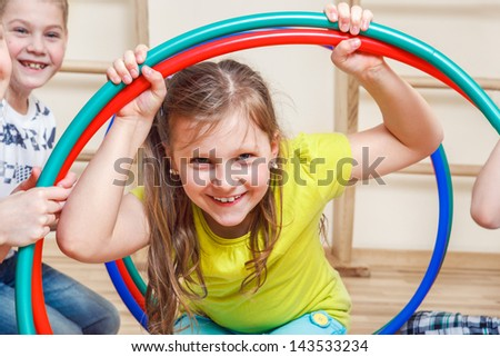 Portrait of a primary school student in gym - stock photo
